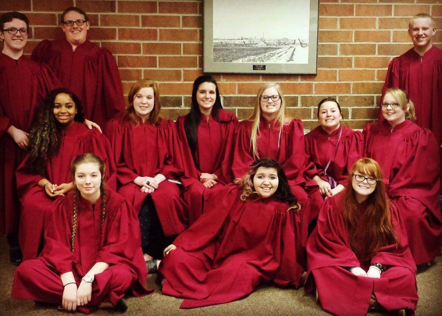 Momentum, a student led choir directed by junior Zach Everly, poses before festival. They were a part of the Pops concert held June 1 in the auditorium.