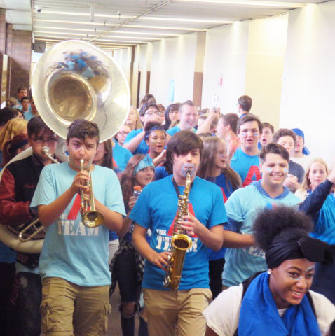 Students in A wing the blue team march through the halls with their band instruments creating a ruckus.