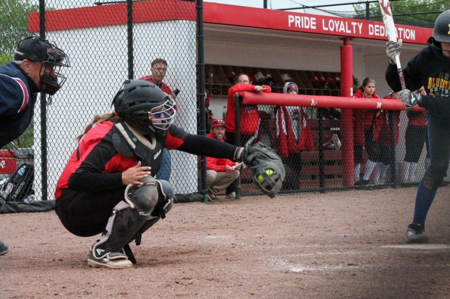 Senior Samantha Spicer catches the ball during the game. Monroe defeated Ida High School in both games of the double header.