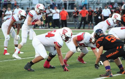 Senior Offensive Lineman Armando Flores and Troy Vajcner prepare to block the Tecumseh Indian's defensive line. The Trojans defeated the Indians 47-13.