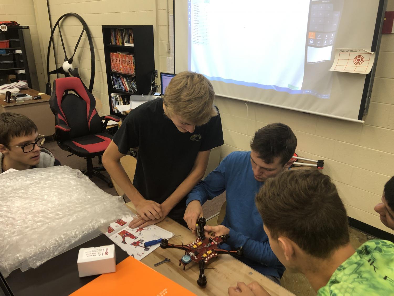 Senior John Kohler and Wyatt Head work on a UAV. The new Electro-Mechanical Drone Design class serves as a math credit for seniors.