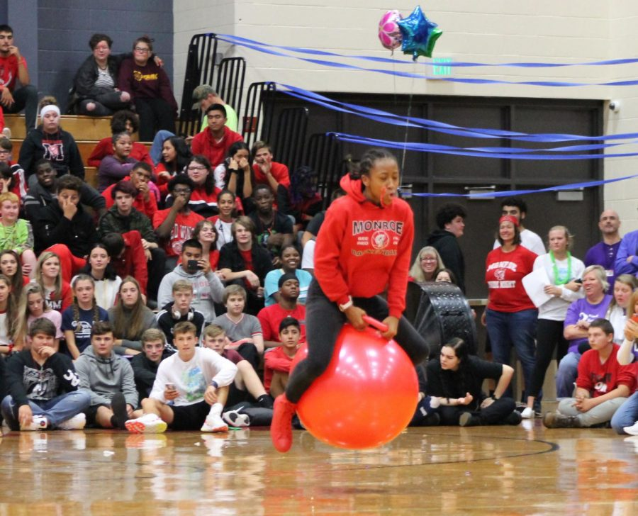 Sophomore Elexus Robinson bounces in the hippity-hop challenge. Robinson wore all red representing C-wing and fought hard in the challenge but finished just short of first place.