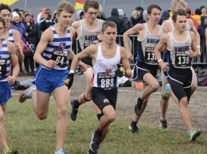 Freshman Luke Butler competes in the MHSAA Division 1 cross country state finals at Michigan International Speedway Nov. 2. He placed 133rd overall and fifth out of all freshman.