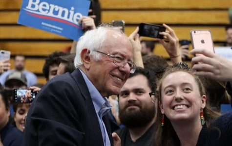 Sanders supporter takes picture with Bernie Sanders after his speech. Sanders encourages young people to vote.