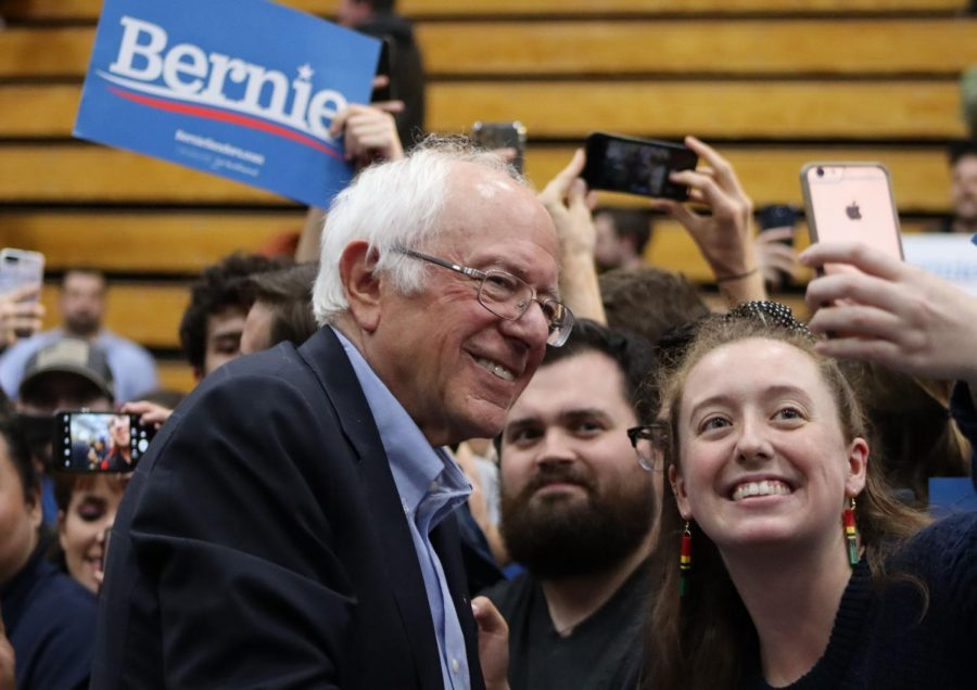 Sanders+supporter+takes+picture+with+Bernie+Sanders+after+his+speech.+Sanders+encourages+young+people+to+vote.+%0A