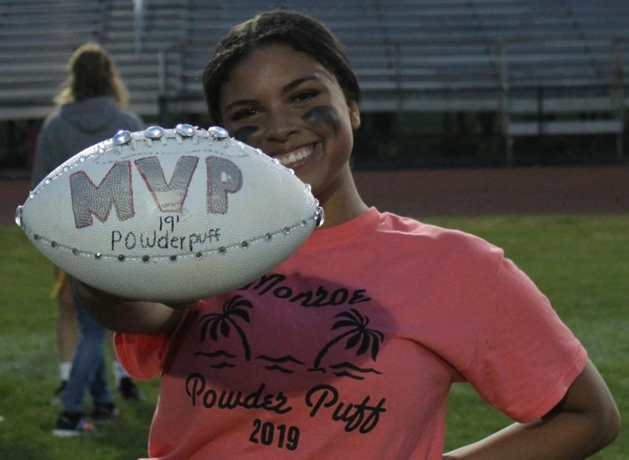 Senior Imari Sorter poses with MVP ball after being announced as the senior MVP. Sorter was awarded the MVP due to her sportsmanship and great defense.