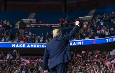 President Trump waves to a crowd of supporters in Tulsa. The campaign rally was met with criticism amid the current COVID pandemic.