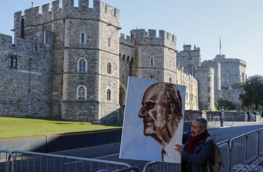 From AP News: artist Kaya Mar holds a portrait of Prince Phillip prior to his funeral on April 17.