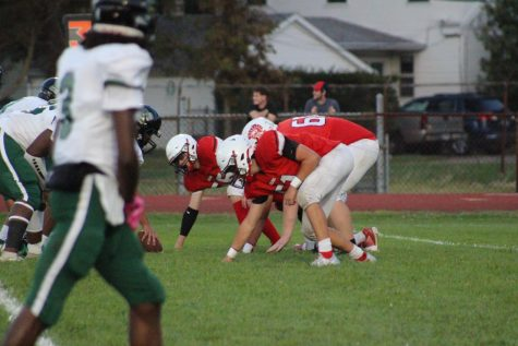 Monroe players line up as they prepare for the next play. This followed a could-be touchdown that was announced as being invalid.