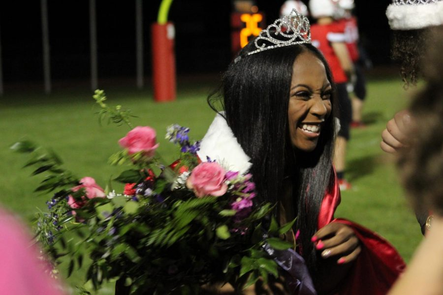 Senior Vannity Anderson smiles as she is crowned Homecoming Queen. Her crown was given to her by Parker Stamper, the 2020 Homecoming Queen.
